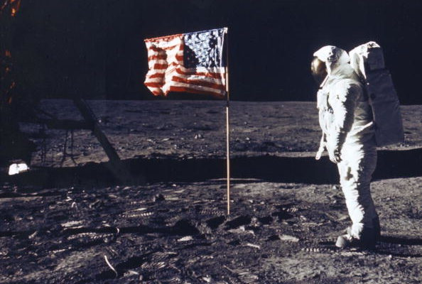 Astronaut Edwin E Aldrin Jr Poses For A Photograph Beside The Deployed Flag Of The United States